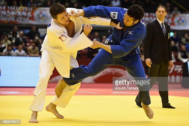 Kaihan Takagi of Japan and Benjamin Fletcher of Great Britain compete in Men's 100kg during Judo Grand Slam Tokyo 2014 at Tokyo Metropolitan...