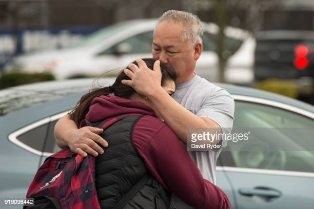 Kaihei Kim comforts his daughter Acacia Kim a high school student that takes classes at Highline College after a threat of an active shooter shut...