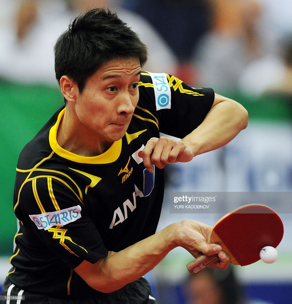 Kaii Yoshida of Japan returns a serve to Ma Lin of China during the men's semi final at the 2010 World Team Table Tennis Championships in Moscow on May 29, 2010.