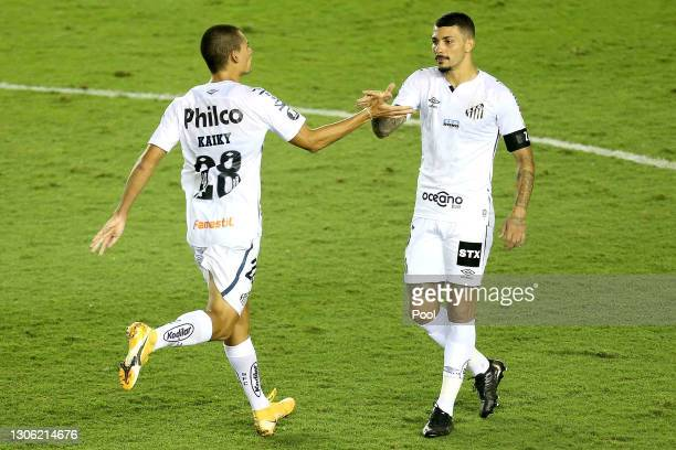 Kaiky of Santos celebrates with teammate Alison after scoring the second goal of his team during a first leg match of second stage of Copa CONMEBOL...