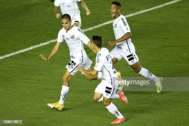 Kaiky of Santos celebrates with teammates after scoring the second goal of his team during a first leg match of second stage of Copa CONMEBOL...