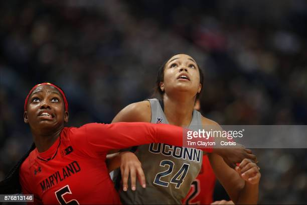 Kaila Charles of the Maryland Terrapins and Napheesa Collier of the Connecticut Huskies jostle for position at a free throw during the the UConn...