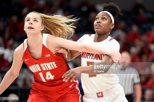 Kaila Charles of the Maryland Terrapins boxes out against Dorka Juhasz of the Ohio State Buckeyes during the Championship game of Big Ten Women's...