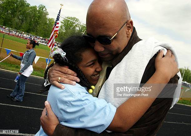 Kailah Clark a student at High Bridge Elementary School gets a supportive hug from her dad Roger Clark after she placed second in the 50 meter dash...
