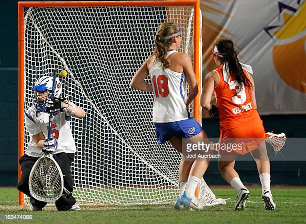 Kailah Kempney of the Syracuse Orange scores a goal past goalkeeper Mikey Meagher of the Florida Gators during the 2013 Orange Bowl Lacrosse Classic...