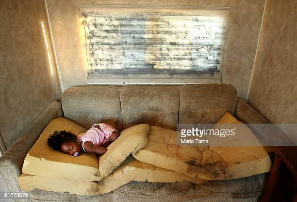Kailah Smith 18 months sleeps on a moldy couch caused by rain leaks in her parents' trailer in the FEMA Diamond trailer park just before the family...