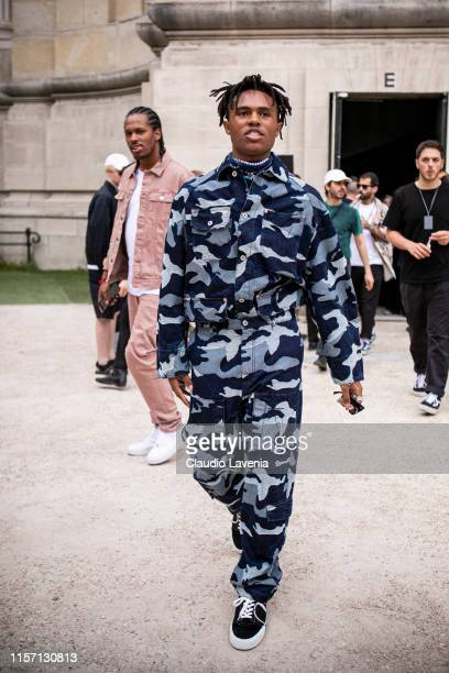 Kailand Morris wearing a blue military print denim jacket with matching pants and black sneakers is seen outside Valentino fashion show on Day 2...