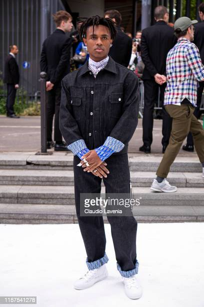 Kailand Morris wearing a Dior denim jacket with matching jeans Dior blue top and white sneakers is seen outside Dior fashion show on Day 4 during the...
