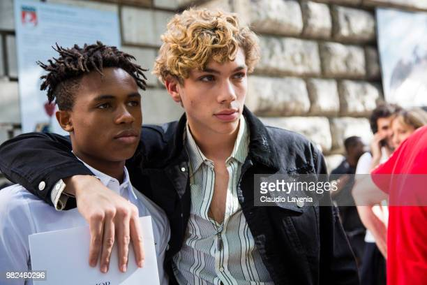 Kailand Morris wearing white shirt and black pants and a guest wearing striped shirt black jacket and black pants are seen in the streets of Paris...