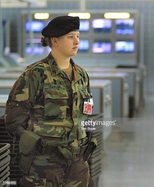 Kailee Taylor of the Illinois National Guard stands guard near her checkpoint October 4 2001 in the United Airlines Terminal at Chicago's O''Hare...