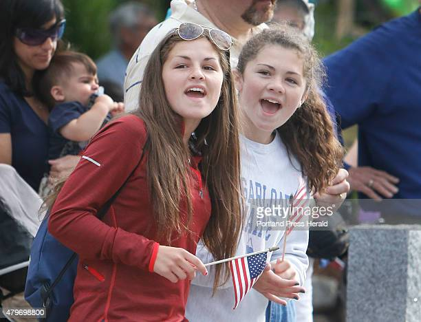 Kaileigh Wimert and her sister Delaney of Falmouth cheer as they watch their mom Rebecca approach the finish line in the LLBean 4th of July 10k road...