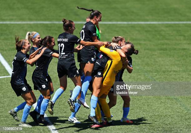 Kailen Sheridan of Sky Blue FC celebrates with her teammates after defeating the Washington Spirit in penalty kicks in the quarterfinal match of the...