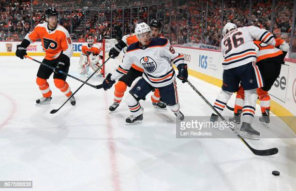 Kailer Yamamoto and Jussi Jokinen of the Edmonton Oilers battle for the puck against Robert Hagg Valtteri Filppula and Shayne Gostisbehere of the...