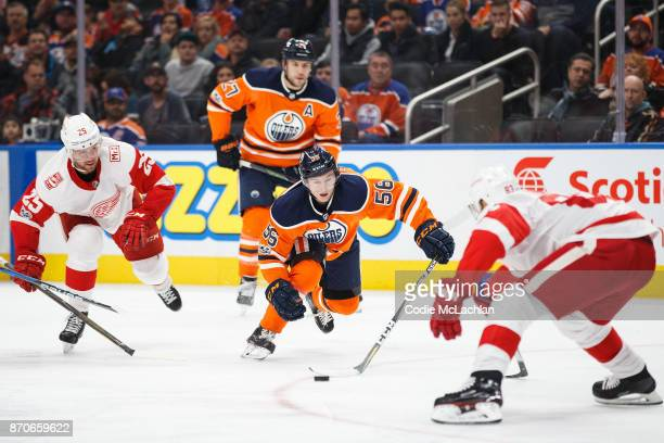 Kailer Yamamoto and Milan Lucic of the Edmonton Oilers attack against Mike Green and Trevor Daley of the Detroit Red Wings at Rogers Place on...