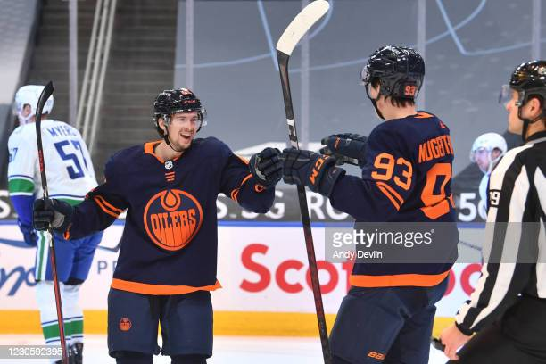 Kailer Yamamoto and Ryan Nugent-Hopkins of the Edmonton Oilers celebrate after a goal during the game against the Vancouver Canucks on January 14,...