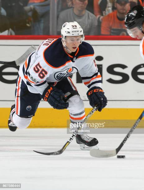 Kailer Yamamoto of the Edmonton Oilers attempts to poke check the puck against the Philadelphia Flyers on October 21 2017 at the Wells Fargo Center...