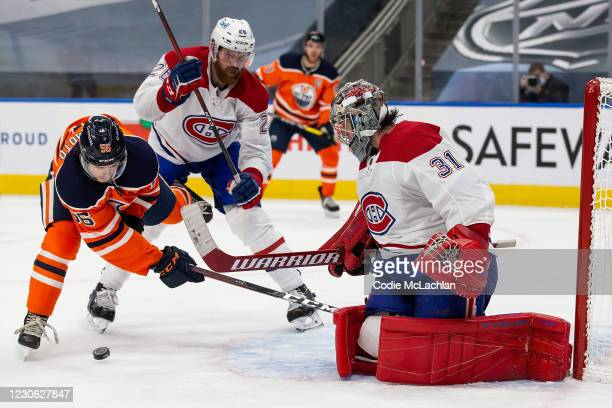 Kailer Yamamoto of the Edmonton Oilers battles against Jeff Petry and goaltender Carey Price of the Montreal Canadiens at Rogers Place on January 16,...
