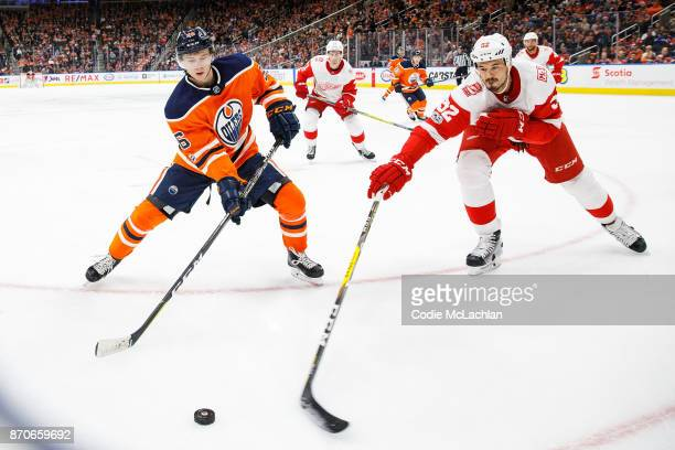 Kailer Yamamoto of the Edmonton Oilers battles against Jonathan Ericsson of the Detroit Red Wings at Rogers Place on November 5 2017 in Edmonton...