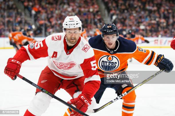 Kailer Yamamoto of the Edmonton Oilers battles against Niklas Kronwall of the Detroit Red Wings at Rogers Place on November 5 2017 in Edmonton Canada