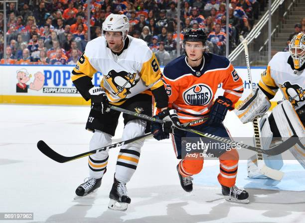 Kailer Yamamoto of the Edmonton Oilers battles for position against Brian Dumoulin of the Pittsburgh Penguins on November 1 2017 at Rogers Place in...