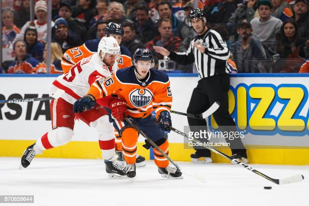 Kailer Yamamoto of the Edmonton Oilers is pursued by Mike Green of the Detroit Red Wings at Rogers Place on November 5 2017 in Edmonton Canada