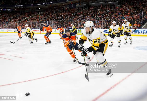 Kailer Yamamoto of the Edmonton Oilers pursues Ian Cole of the Pittsburgh Penguins at Rogers Place on November 1 2017 in Edmonton Canada