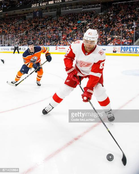Kailer Yamamoto of the Edmonton Oilers skates against Trevor Daley of the Detroit Red Wings at Rogers Place on November 5 2017 in Edmonton Canada