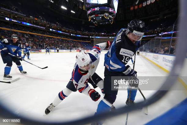 Kailer Yamamoto of United States and Eetu Tuulola of Finland fight for position in a corner in the first period during the IIHF World Junior...