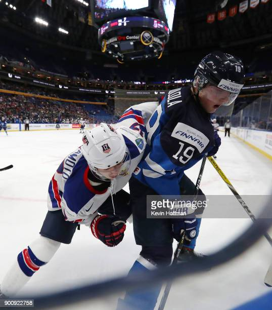 Kailer Yamamoto of United States and Eetu Tuulola of Finland in the first period during the IIHF World Junior Championship at KeyBank Center on...