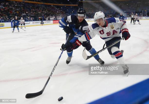 Kailer Yamamoto of United States and Miro Heiskanen of Finland in the third period during the IIHF World Junior Championship at KeyBank Center on...