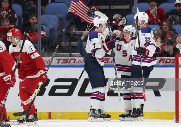Kailer Yamamoto of United States celebrates his goal against Denmark with Brady Tkachuk and Logan Brown in the first period during the IIHF World...