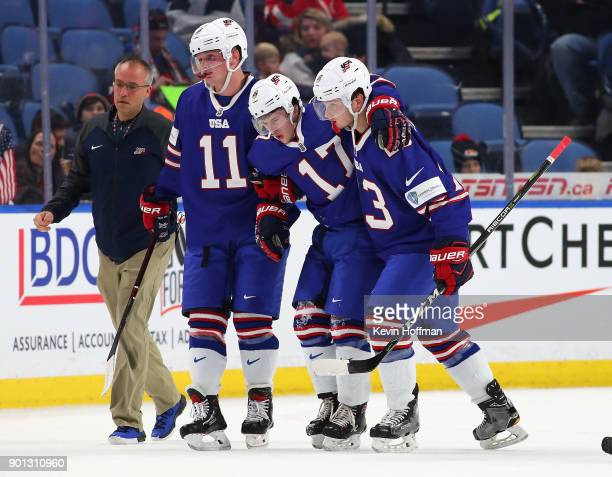Kailer Yamamoto of United States is helped off the ice after being shaken up in the third period against Sweden during the IIHF World Junior...