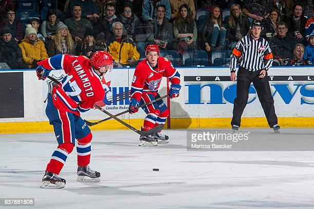 Kailer Yamamoto passes the puck to teammate and brother Keanu Yamamoto of the Spokane Chiefs against the Kelowna Rockets on January 4, 2017 at...