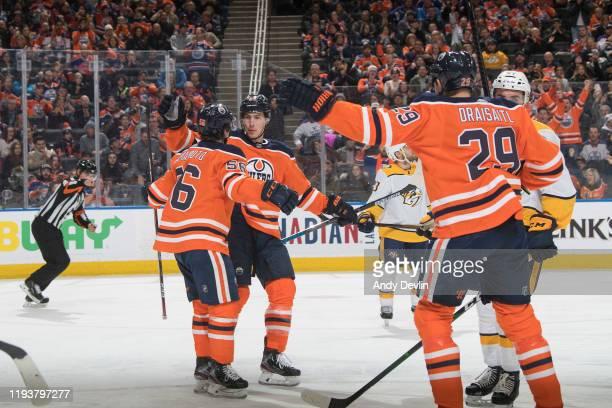 Kailer Yamamoto, Ryan Nugent-Hopkins and Leon Draisaitl of the Edmonton Oilers celebrate a goal against the Nashville Predators on January 14 at...
