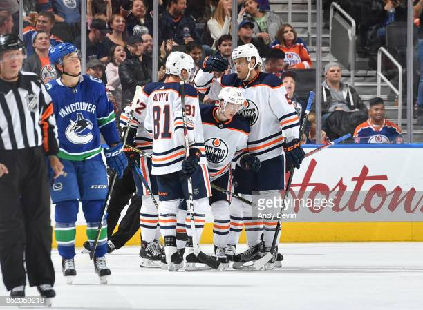 Kailer Yamamoto Yohann Auvitu and Mark Fayne of the Edmonton Oilers celebrate after a goal during the preseason game against the Vancouver Canucks on...