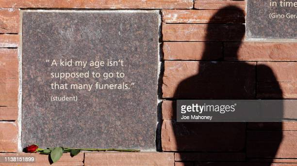 Kailey Slusher's shadow is cast on the Columbine Memorial on April 19 2019 in Littleton Colorado April 20 will mark 20 years since the shooting that...