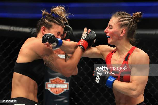 Kailin Curran fights Alexandra Albu of Russia during their Woman Strawweight fight at UFC 214 at Honda Center on July 29 2017 in Anaheim California