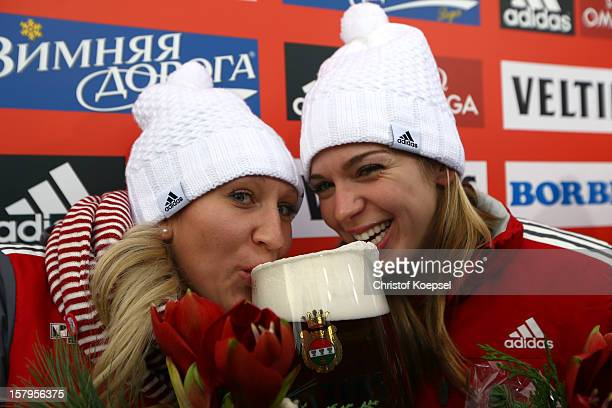 Kaillie Humphries and Chelsea Valois of Canada drink beer after winning the two women's bob competition during the FIBT Bob & Skeleton World Cup at...