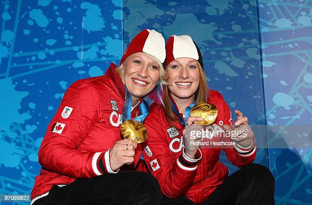 Kaillie Humphries and Heather Moyse of Canada celebrate receiving the gold medal during the medal ceremony for the women's two-man bobsleigh held at...