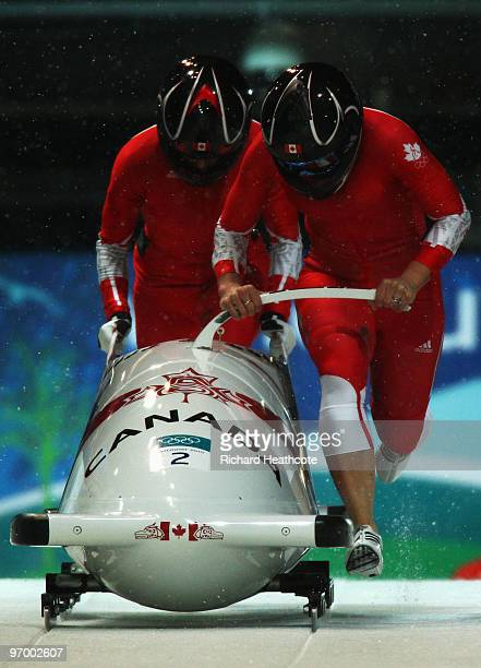 Kaillie Humphries and Heather Moyse of Canada compete in Canada 1 during the Women's Bobsleigh Heat 2 on day 12 of the 2010 Vancouver Winter Olympics...