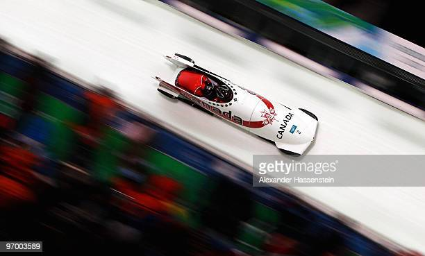 Kaillie Humphries and Heather Moyse of Canada compete in Canada 1 during the Women's Bobsleigh race on day 12 of the 2010 Vancouver Winter Olympics...