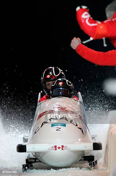 Kaillie Humphries and Heather Moyse of Canada in Canada 1 complete their fourth run to finish in first place and win the gold during the womens...