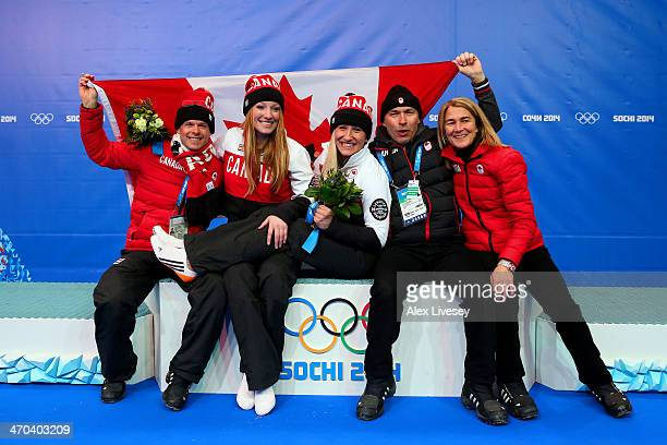 Kaillie Humphries and Heather Moyse of Canada team 1 celebrate after winning the gold medal with Chef de Mission Steve Podborski during the Women's...