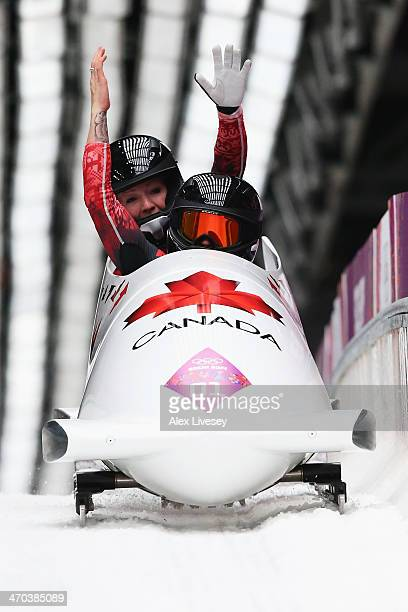 Kaillie Humphries and Heather Moyse of Canada team 1 celebrate as the cross the finsih line during the Women's Bobsleigh on Day 12 of the Sochi 2014...
