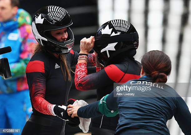 Kaillie Humphries and Heather Moyse of Canada team 1 celebrate before winning the gold medal during the Women's Bobsleigh on Day 12 of the Sochi 2014...