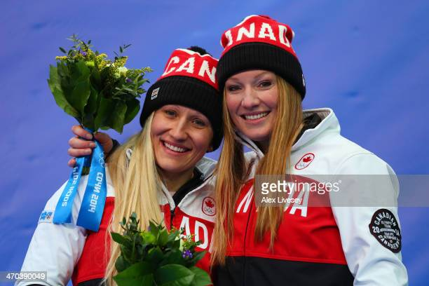 Kaillie Humphries and Heather Moyse of Canada team 1 celebrate during the flower ceremony after winning the gold medal during the Women's Bobsleigh...