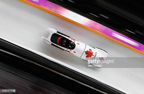 Kaillie Humphries and Heather Moyse of Canada team 1 make a run during the Women's Bobsleigh heats on day 11 of the Sochi 2014 Winter Olympics at...