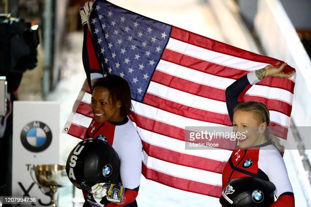 Kaillie Humphries and Lauren Gibbs of the United States celebrate winning the gold medal after the Women's Bobsleigh during day 2 of the BMW IBSF...