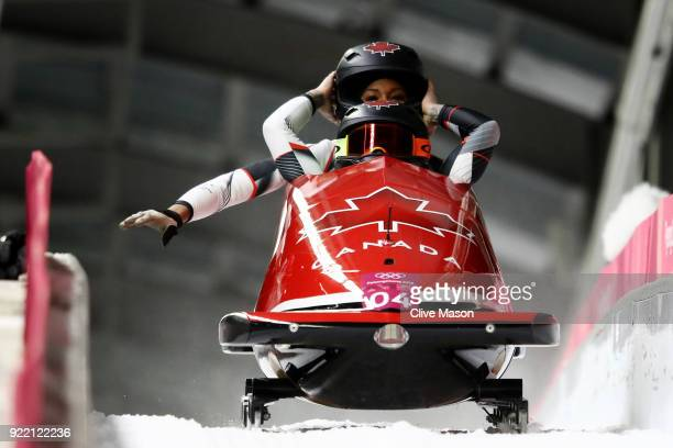 Kaillie Humphries and Phylicia George of Canada react in the finish area during the Women's Bobsleigh heats on day twelve of the PyeongChang 2018...