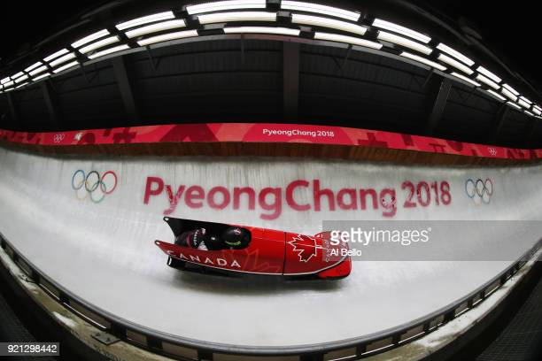 Kaillie Humphries and Phylicia George of Canada slide during the Women's Bobsleigh heats at the Olympic Sliding Centre on day eleven of the...